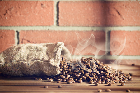 the roasted coffee beans in burlap sack