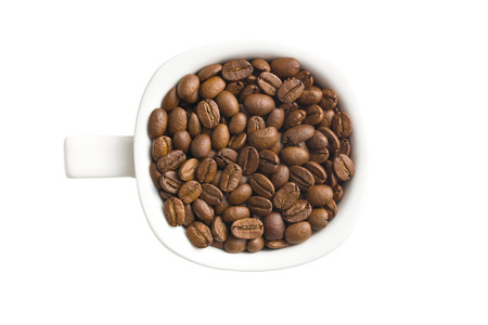 top view of coffee beans in mug photo