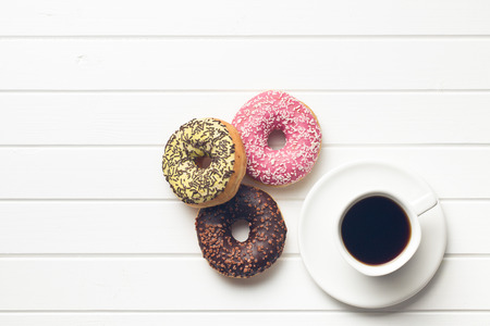 top view of various donuts with coffee Foto de archivo