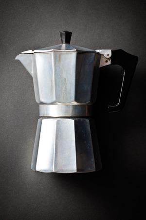 espreso: coffee maker bialetti on black background