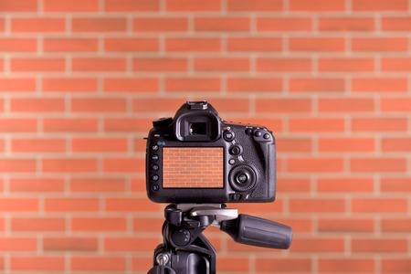 microstock: the DSLR Camera on tripod shooting brick wall
