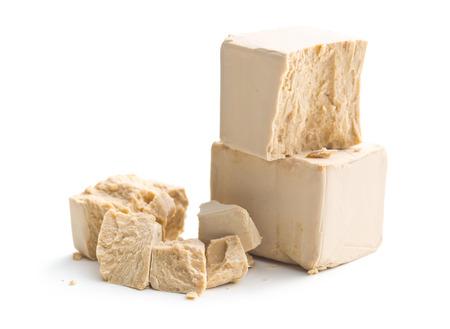 leavening: fresh yeast on white background