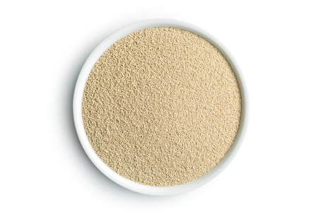 yeast: dry yeast in bowl on white background