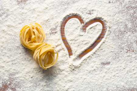 eating pasta: top view of heart and pasta