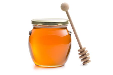 honey jar: honey in a jar on white background