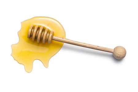 honey dipper on white background