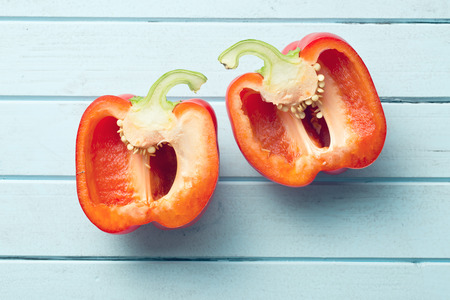 halved: top view of halved red bell pepper on table