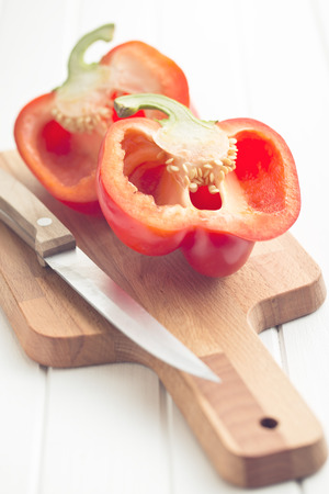 halved: halved red bell pepper on kitchen table Stock Photo