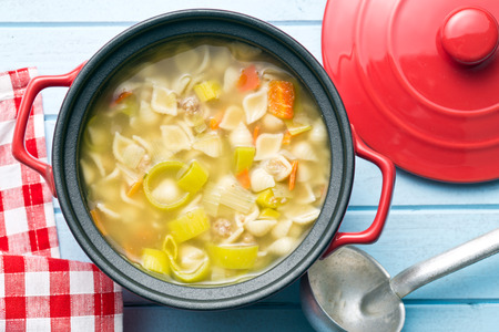 hot soup: vegetable soup with pasta in pot