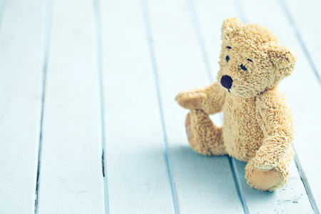the teddy bear on blue table Stock Photo