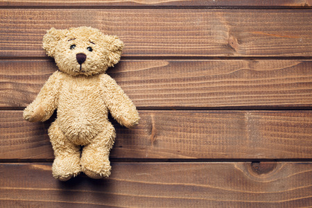 the teddy bear on wooden table Stok Fotoğraf - 37184230