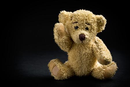 vintage teddy bears: the teddy bear on black background Stock Photo