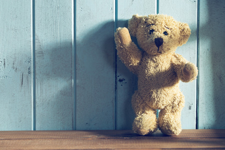 teddy bear love: the teddy bear stands in front of a blue wall