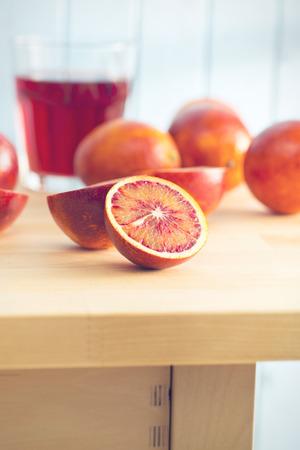 citrous: halved blood orange on kitchen table Stock Photo
