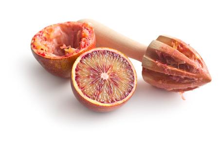 citrous: halved blood orange and juicer on white background Stock Photo