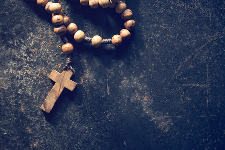 rosary beads: rosary beads on old black background