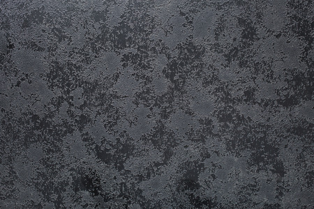 black textured background: the abstract black textured background