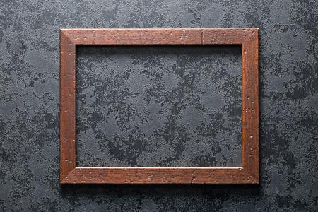 black textured background: old wooden frame on black textured background