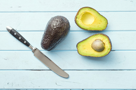halved: top view of halved avocado on table Stock Photo