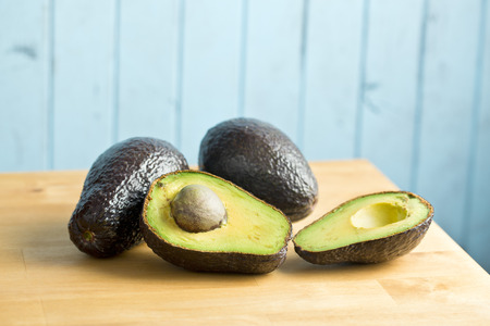 halved: the halved avocado on kitchen table