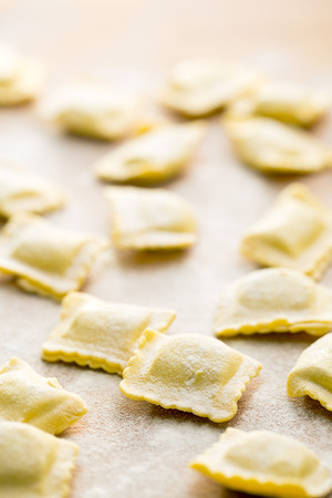 raviolo: ravioli pasta on kitchen table Stock Photo