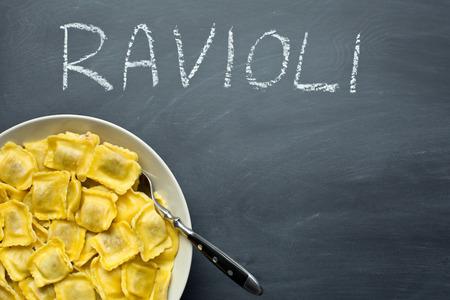 raviolo: cooked ravioli pasta on chalkboard