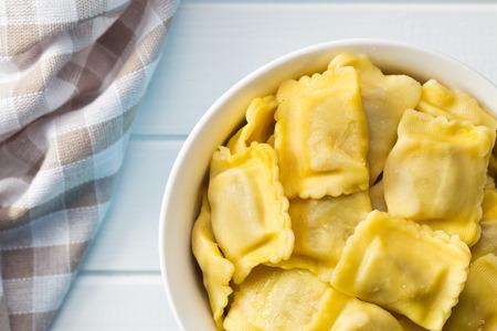 raviolo: the cooked ravioli pasta in bowl