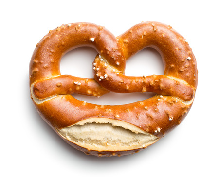 baked pretzel on white background Reklamní fotografie