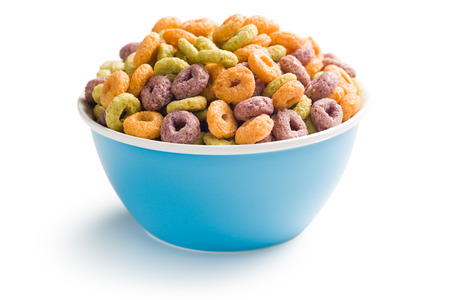 cornflakes: colorful cereal rings in bowl on white background