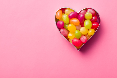 jelly beans: heart made from jelly beans on pink background
