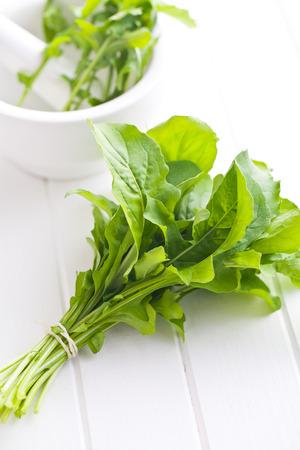 rukola: fresh arugula leaves on kitchen table