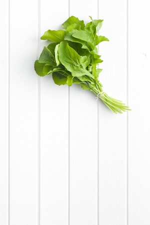 rukola: top view of fresh arugula leaves on kitchen table Stock Photo