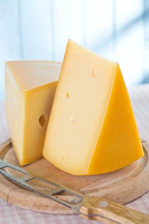 edam: block of edam cheese on kitchen table