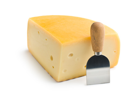 edam: edam cheese and knife on white background