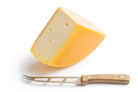 edam: edam cheese and knife on white background