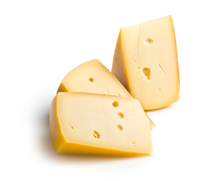 edam: block of edam cheese on white background