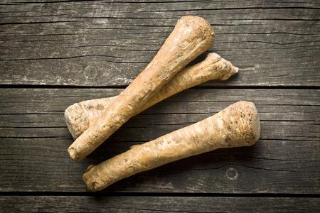 horseradish: fresh horseradish root on old wooden table