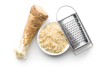 horseradish: grated horseradish root on white background