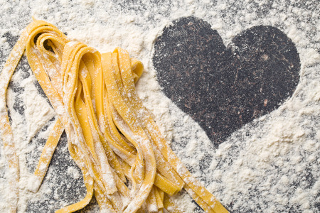 spaghetti dinner: the homemade pasta and heart Stock Photo