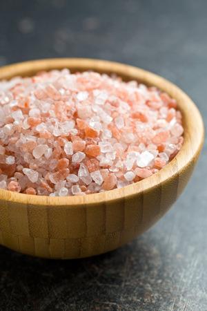 tibet bowls: Himalayan salt in wooden bowl Stock Photo