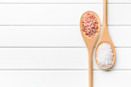 Himalayan and white salt in spoon