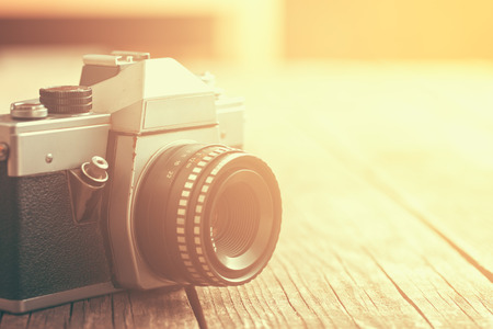 analogue: retro analogue camera on old wooden table Stock Photo