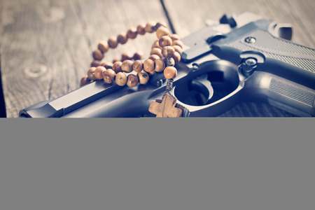 rosary beads: the rosary beads and gun