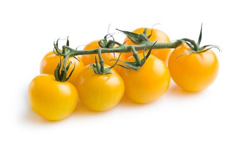 cereza: tomates amarillos en el fondo blanco Foto de archivo