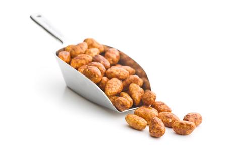 sugared almonds: sugared almonds in scoop on white background Stock Photo