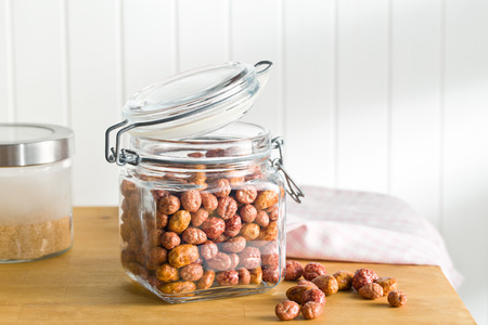 sugared: various sugared nuts in jar on kitchen table