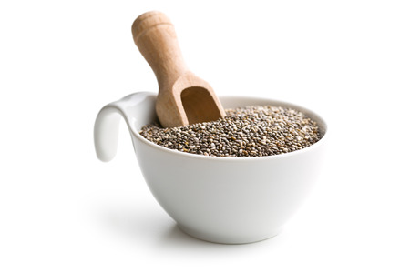 chia seeds in bowl on white background
