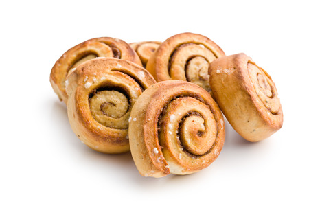cinnamon buns on white background