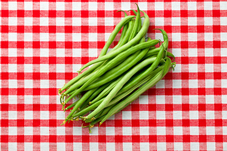 tablecloth: green beans on checkered tablecloth