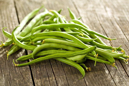 green beans on old wooden table